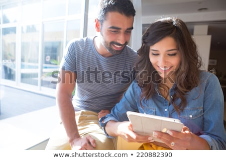 Smiling couple of business people using a computer Stock photo © Minervastock