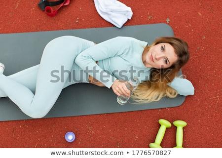 Jóvenes deportes mujer aire libre mentiras imagen Foto stock © deandrobot