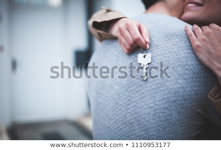 happy couple with keys of new home Stock photo © dolgachov