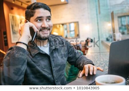 улыбаясь · Hispanic · бизнесмен · говорить · телефон · красивый - Сток-фото © diego_cervo