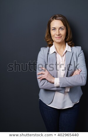 elderly woman on studio dark gray background stock photo © Lopolo