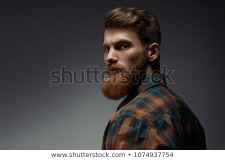 Portret ernstig jonge bebaarde man naar Stockfoto © deandrobot