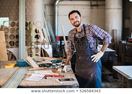 Carpenter working carefully looking at the plans work in carpent Stock photo © snowing