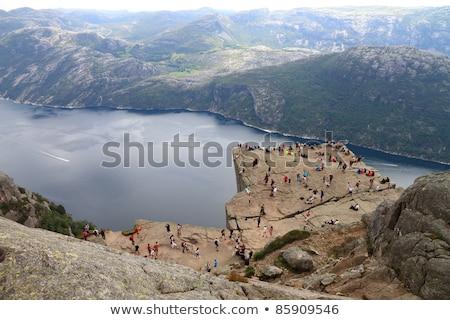 Fickó kő Norvégia elképesztő szirt fölött Stock fotó © Kotenko