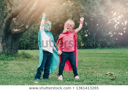 Two boys playing hero in the park Stock photo © colematt