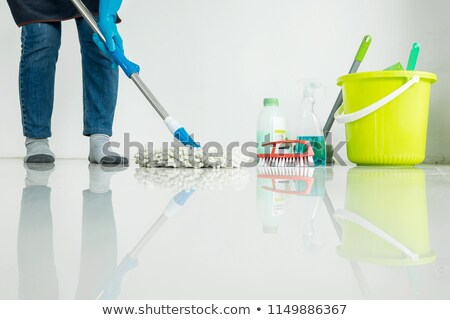 Young housekeeper cleaning floor mobbing holding mop and plastic Stock photo © snowing