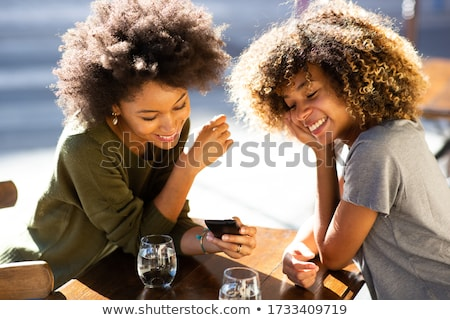 Stock photo: Woman sitting in cafe outdoors