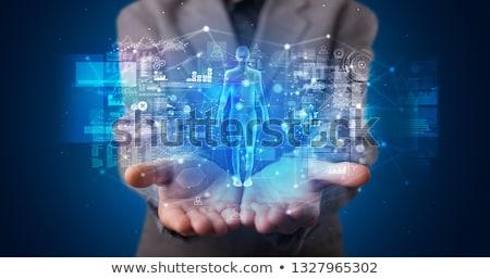 Fiatal személy tart hologram biztonság szimbólumok Stock fotó © ra2studio