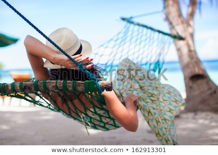 Rear View Of A Young Woman Relaxing On Hammock Stock photo © AndreyPopov