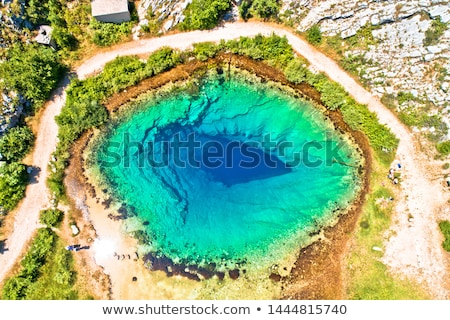 Cetina river source or the eye of the Earth aerial view Stock photo © xbrchx