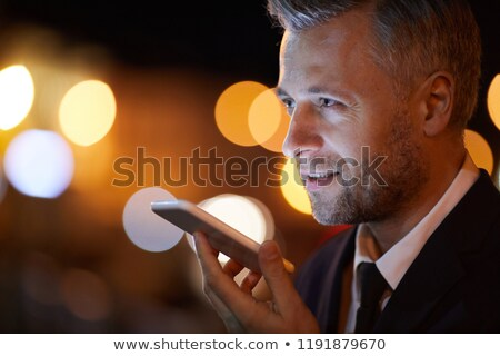 Mobile elegant businessman recording voice message on smartphone Stock photo © pressmaster