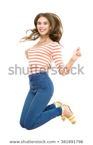 Mulher jovem saltando para cima jovem mulher atraente alegremente Foto stock © nyul