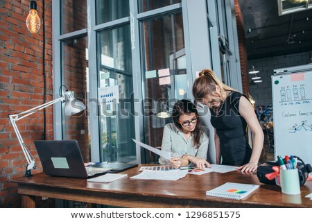 Two young colleagues discussing color swatches by workplace Stock photo © pressmaster