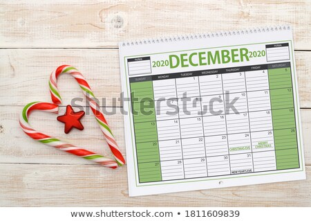 close up of calendar and heart shaped candies Stock photo © dolgachov