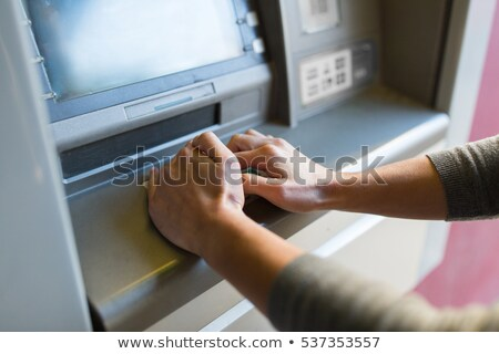 Close-up Of Hand Entering Pin At An ATM Stock photo © AndreyPopov