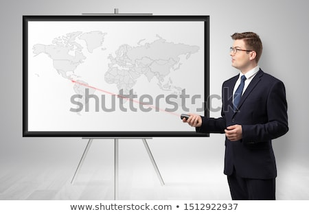 Businessman presenting potential business area on map Stock photo © ra2studio