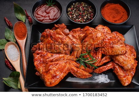 Spicy chicken wings with garlic and lemon marinade Stock photo © brebca