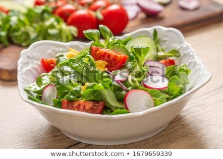 Saudável salada prosciutto tomates ovo folhas verdes Foto stock © furmanphoto