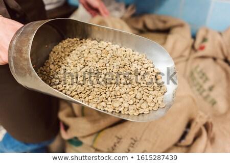 Koffie handelaar tonen ruw product schop Stockfoto © Kzenon