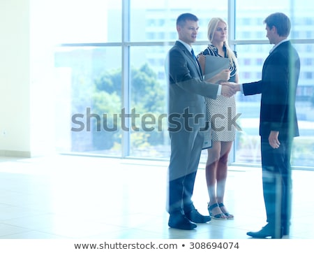 Mature businessman shaking hand of business partner after negotiation Stock photo © pressmaster