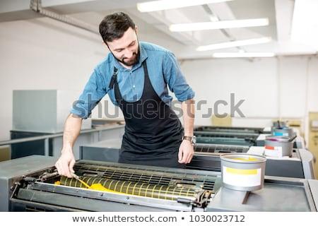 Printing press operator at work Stock photo © pressmaster