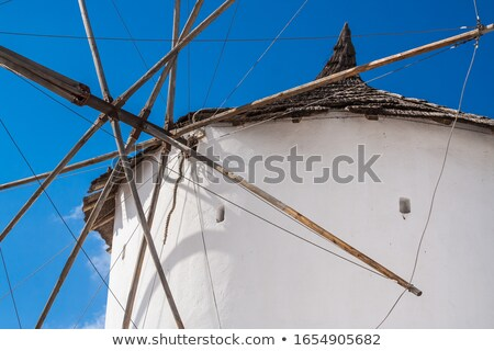 Majestic Windmill on Santorini Greece Against Deep Blue Sky Stock photo © feverpitch