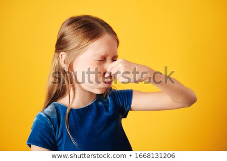 Little Redhead Girl Covering Nose For Bad Smell Stock photo © diego_cervo