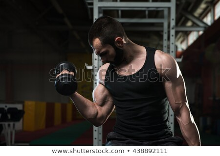 молодым человеком трицепс стороны человека фитнес Сток-фото © Jasminko
