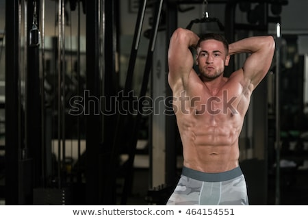 Handsome Man Exercising His Abs At The Gym Stock photo © Jasminko