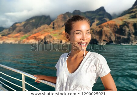 Cruise ship boat tourist on Na Pali Coast of Kauai, Hawaii. Sunset cruise ride leisure activity happ Stock photo © Maridav