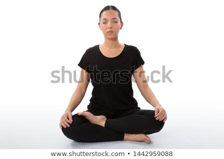 Fit Woman Practicing Sukhasana Yoga Pose Stock photo © rognar