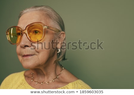 Portrait of a beautiful woman up-close and wearing an earing Stock photo © HASLOO