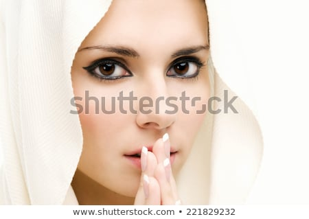 praying beautiful woman with covered head stock photo © pilgrimego