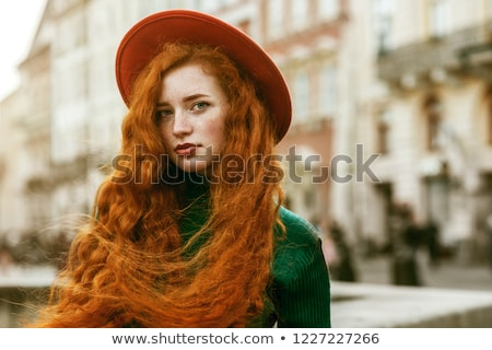 beautiful woman in red with very long hair stock photo © pilgrimego