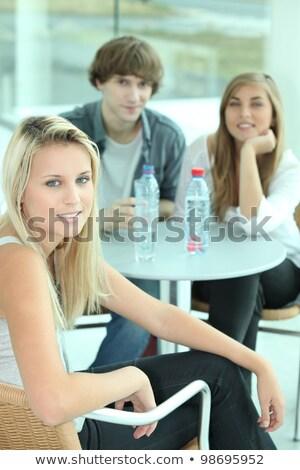 Młodych dziewcząt pitnej woda butelkowana bar wody Zdjęcia stock © photography33