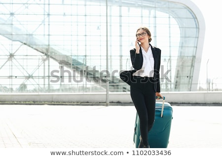 young business woman and suitcase stock photo © imarin