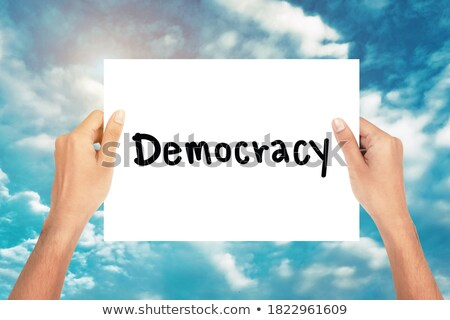 The word Democracy on blue paper Stock photo © deyangeorgiev