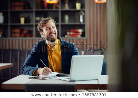 Casually dressed man using a laptop computer Stock photo © photography33