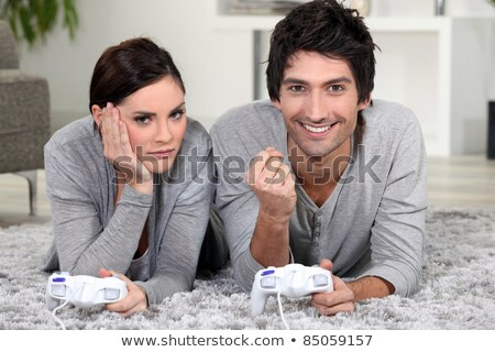 Couple laying down playing video games Stock photo © photography33