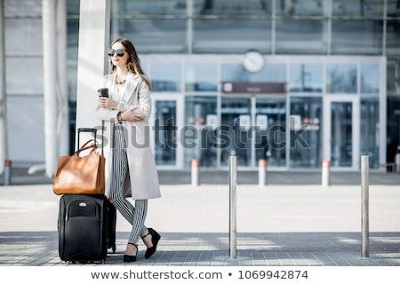 Stok fotoğraf: Businesswoman With Luggage Waiting