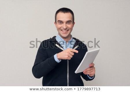 Stockfoto: Knap · jonge · zakenman · wijzend · spiraal · notebook