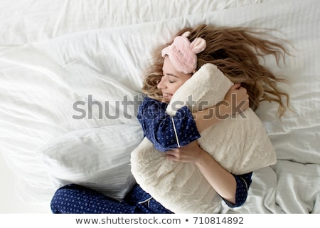 pretty blonde hugging her pillow in the morning stock photo © stryjek