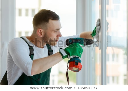 builder using an electric screwdriver stock photo © photography33
