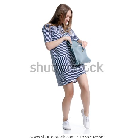 Woman searching for something in her bag Stock photo © photography33
