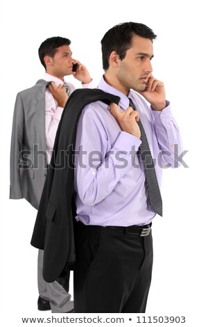 Two businessmen stood taking on their mobile telephones Stock photo © photography33
