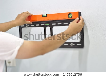 Couple installing a television Stock photo © photography33