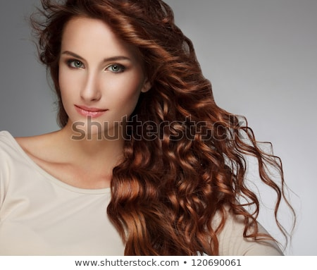 Beautiful woman with red hairstyle luxuriant long hair. Stock photo © Victoria_Andreas