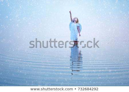 angel in water stock photo © dolgachov