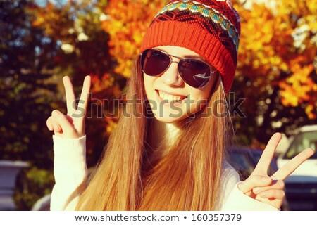 piękna · dziewczyna · objętych · pozostawia · jesienią · parku · dziewczyna - zdjęcia stock © victoria_andreas