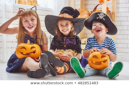 young brother and sister in halloween costume stock photo © stockyimages